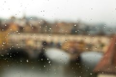 Rain drops on a window. With the  Ponte Vecchio Bridge over the Arno River in the background, Florence , Italy royalty free stock image