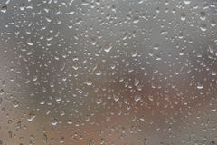 Rain drops on window,. Against blurry background of a town Stock Images
