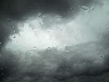 Rain drops on window. With blurry dramatic sky, weather background royalty free stock photos