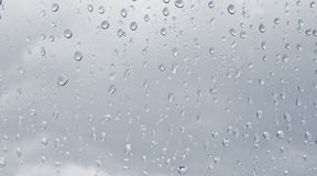 Rain drops on the window. It's going to bright outside Stock Photo