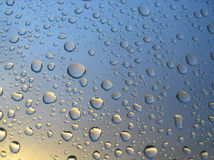 Rain drops on the window, sunset in background, stormy clouds behind #4 Stock Photos