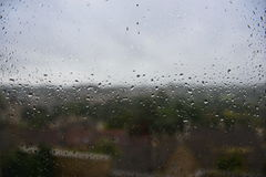Rain Drops on a Window. View of Rain Water Drops on a Window during Stormy Weather Royalty Free Stock Image