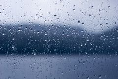 Rain drops on a window or water drops on glass background Stock Images