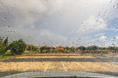 Rain drops on a windscreen in an empty car park Royalty Free Stock Photo