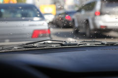 Rain drops on windshield Stock Photos