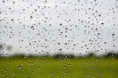 Rain drops on the windshield, Abstract blur background Royalty Free Stock Photo