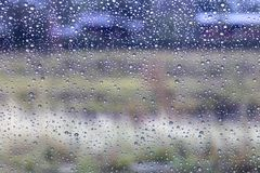 Rain drops on windshield with rural. Royalty Free Stock Photo