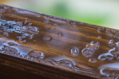Rain drops on a wooden window sill Royalty Free Stock Photo