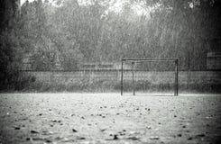 Cold summer rain on empty football field