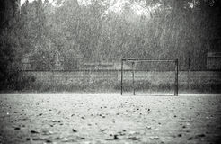 Cold summer rain on empty football field Stock Photography