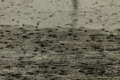 Rain fall on the road. Royalty Free Stock Photography