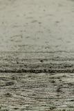 Rain fall on the road. Royalty Free Stock Photo