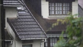 Rain falling on cozy cottages, downpour in old European village, weather. Stock footage stock video footage