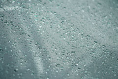 Rain falling on glass (rain-drops). RAIN-DROPS FALLING ON GLASS Stock Photos