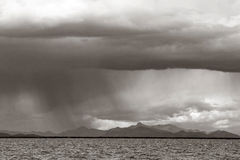 Rain falling over Lake Titicaca, Peru Stock Image