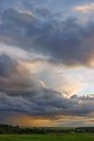 Rain far away on sunset. Evening sunset landscape with rain on long way Stock Photos