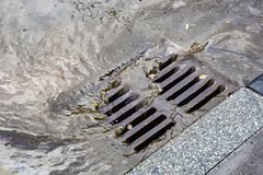 Free Rain Flowing Into A Storm Water Sewer System Royalty Free Stock Images - 121213419