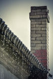Rain flows down from a roof down Royalty Free Stock Image