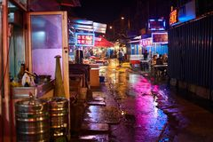 Rain in the food stalls in Qingdao, China. stock photo