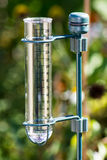 Rain gauge in the garden Stock Photo