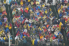 Rain gear clad guests attend the official opening ceremony of the Clinton Presidential Library November 18, 2004 in Little Rock, A Stock Image