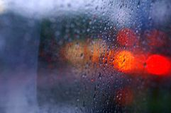 Rain on the glass. Rain  glass light colorful bus Royalty Free Stock Photo
