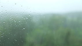 Rain on glass stock video footage