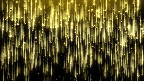 A rain of glitter golden particles