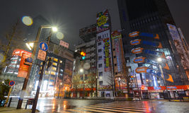 Rain glitters in the night lights of Akihabara, Tokyo`s famous electronics shopping district popular with geeks and gamers. Tokyo, Japan - April 8, 2017 - Tokyo Stock Photos