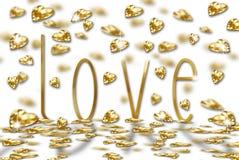 Rain of golden hearts on love word Stock Photo