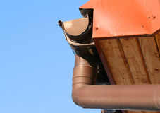 Rain gutter. On house with blue sky in the bakcground Royalty Free Stock Image