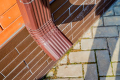Rain gutter downspout pipe Royalty Free Stock Images