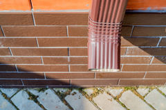 Rain gutter downspout pipe stock photo