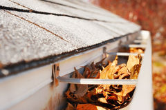 Rain Gutter full of leaves Stock Photos