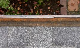 Rain gutter on home cleared of debri Stock Photography