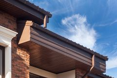Rain gutter on a modern brick house with plastic windows. Rain gutter on a modern brick house with plastic windows stock photography
