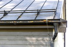 Rain gutter pipeline system installation. Roofing construction. Rain gutter system and roof protection from snow Snow guard Stock Photo