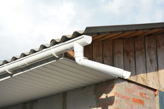 Rain Gutter with Soffit and Fascia on Garage Roof. Stock Photo