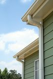 Rain gutters on a home. Rain gutters or downspouts on a home royalty free stock photo