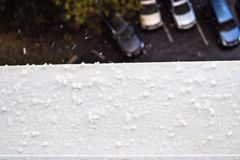 Rain and hail fall on the window sill stock image