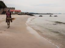 After The Rain At Hua Hin Beach. Ride a horse after the rain at Hua Hin beach Stock Photography