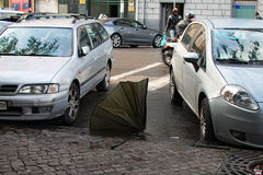 After a rain the inhabitants throw out the broken umbrellas on the street. Naples, ITALY, January 05, 2017: After a rain the inhabitants throw out the broken Royalty Free Stock Photos