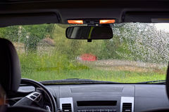Rain from the inside car Royalty Free Stock Images