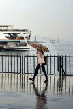 Rain in Istanbul, People are trying to reach the ferry pier in K. Istanbul, Turkey - April 18, 2014: Rain in Istanbul,, People are trying to reach the ferry pier Royalty Free Stock Photography