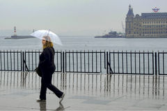 Rain in Istanbul, People are trying to reach the ferry pier in K Royalty Free Stock Photos