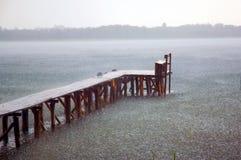 Rain on the lake. Rainy day. Bridge in the lake Stock Image