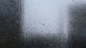 Rain, Large rain drops strike a window during a. Rain, Large rain drops strike a window pane during a shower on a cloudy day