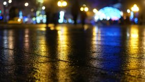 Heavy Rain, Busy Street. Car and Traffic Lights Reflect on a Rainy Road at Night. Rain lights reflect on a road at night stock video footage