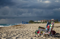 Before the rain. Lounge on empty beach before a storm Royalty Free Stock Image
