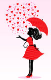 Rain of love. Silhouette of a girl under a rain of hearts Stock Photo
